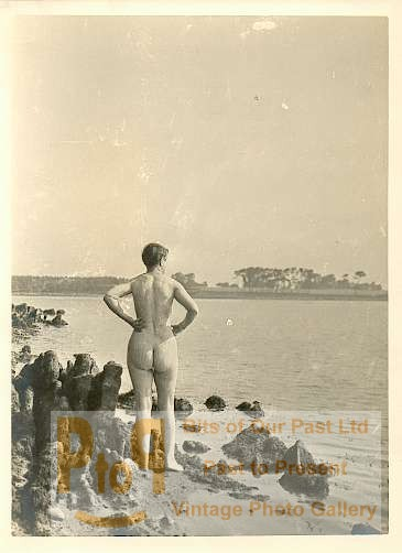 Nude girl standing on the beach