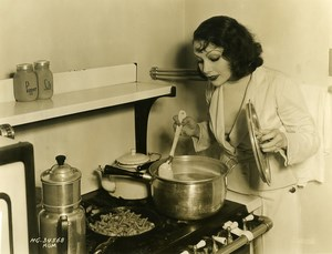 Lupe Velez preparing the family meal MGM Photo 1932