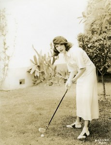 Lupe Velez taking golf lessons in the garden of her house MGM Photo 1932