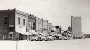 Nebraska Gordon Main street? Shops Automobiles old RPPC Photo 1952