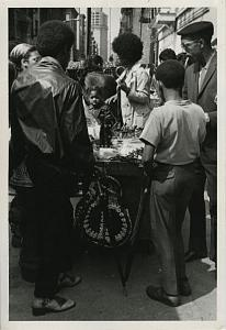 People at Street Retailer Stand Chris Mackey Photo 1970